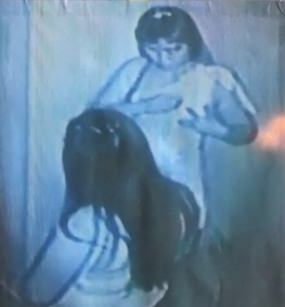 A surveillance video shows one of the two women allegedly applying Alprazolam to her nipple before drugging a customer.