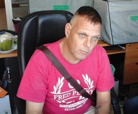 Police claim Paul Stephen Davies is a fugitive wanted back in Britain.