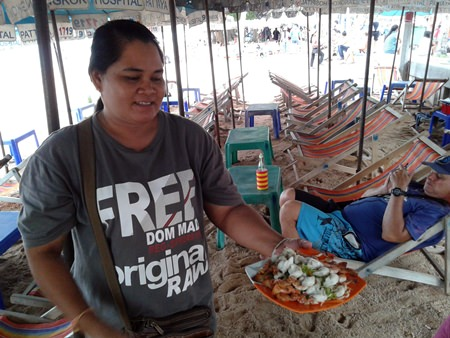 Wandee, a beach chair and umbrella vendor on the beach in front of Royal Garden Plaza, said these days she relies more on Thai tourists to survive and by selling food at reasonable prices.