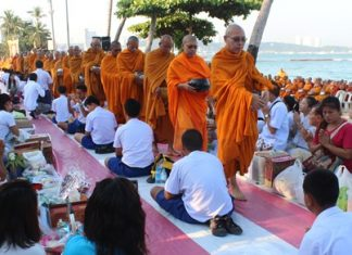 During morning alms, 1,199 monks gather money and necessities destined for monks in Thailand's troubled south.