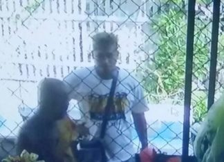 Police are looking for Somchai Boonsri, captured on close-circuit camera grabbing and holding a blade to the throat of a 70-year-old monk in a fit of rage.