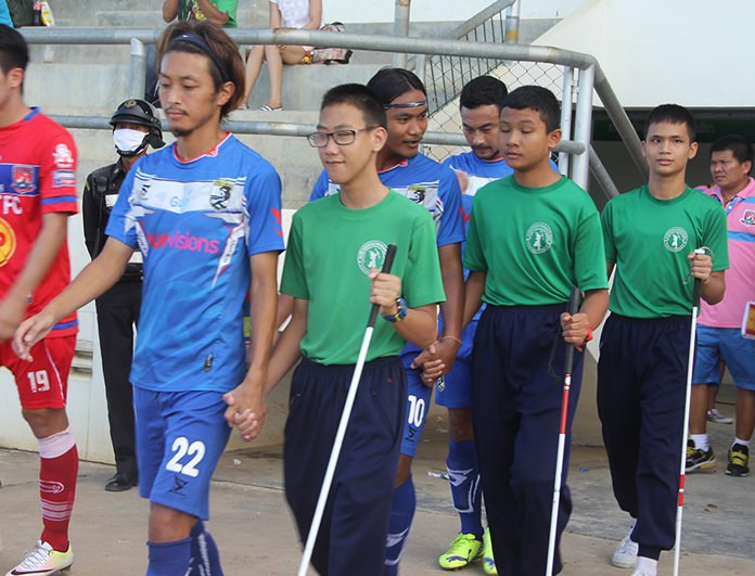 The blind students became mascots for the match.