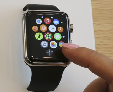 In this April 10, 2015, file photo, a customer demonstrates the Apple Watch at an Apple Store in Tokyo. Upcoming changes to Apple and Android smartwatches should address many of the frustrations the first generation of owners have, though the improvements alone might not be enough to win over those still on the fence. (AP Photo/Koji Sasahara, File)