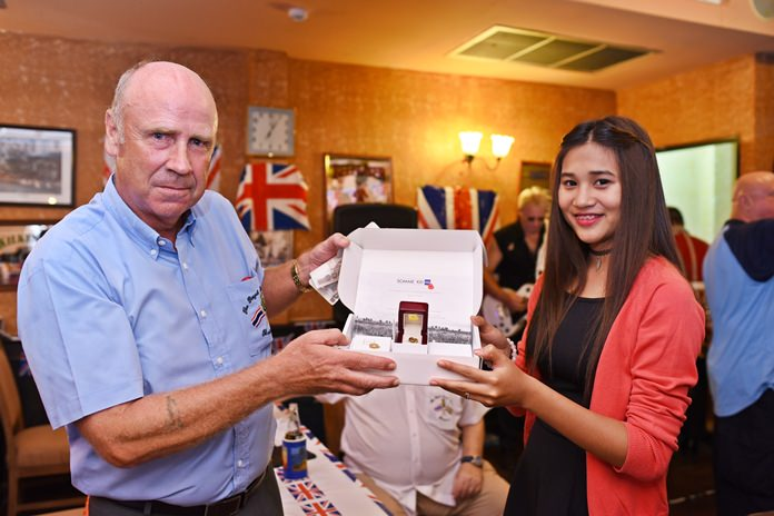Founder member of the RBL George Barrie shows off the limited edition gold poppy pin with his lovely daughter Kaew.