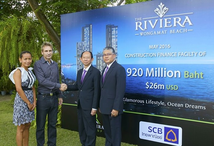 (L to R) Projects Director Sukanya Gale looks on as Riviera Group Owner Winston Gale shakes hands with FS.V.P. Sommai Ungsrithong and Chonburi Regional Manager Anol Eaksil. The Riviera Group brought to a conclusion the signing of a 920 million baht construction loan for The Riviera, Wongamat Beach on Tuesday the 24 of May.