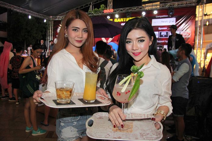 Pretty waitresses bring the concoctions to the judges.
