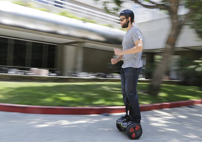 In this May 27, 2016, file photo, company representative Zach Servideo demonstrates Segway's new self-balancing scooter, the MiniPro, in downtown Los Angeles. (AP Photo/Reed Saxon, File)