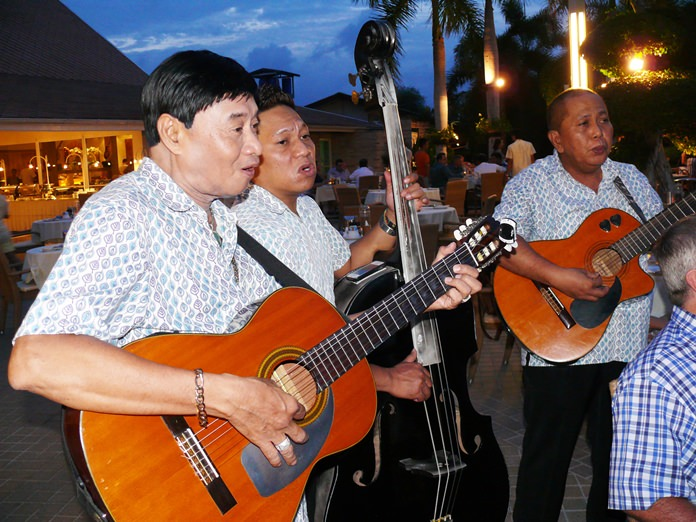 The strolling trio entertains the guests.