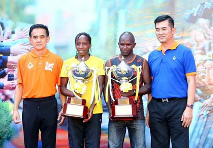 Noah Kutung Chepsergon and Wachira Tabitha Wambui are presented with the prestigious King's Cup trophies after winning the men's and women's marathon races respectively.