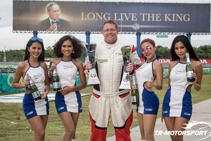 Danish driver Thomas Raldorf (center) of team TR-Motorsport poses with his two second place trophies at the Chang International Circuit in Buriram, July 10.