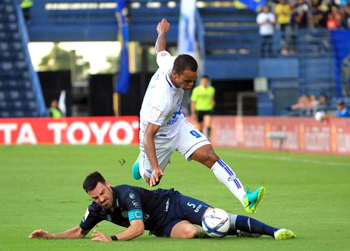 Pattaya United's 'Pinto' Junior Negrao (9) hurdles over a challenge from Buriram United's Andrés Tunez (5) during their Thai Premier League match at the Thunder Castle Stadium in Buriram, Sunday, July 17. (Photo courtesy Pattaya United)