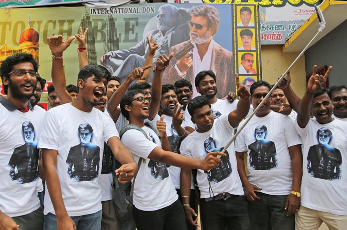 "Fans of Indian superstar Rajinikanth take a selfie outside a cinema hall to celebrate the screening of ""Kabali"" in Chennai, India, Friday, July 22. (AP Photo/Aijaz Rahi)"