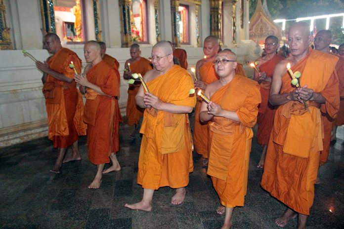 Temple monks lead the wien tien procession for Asalaha Bucha Day.