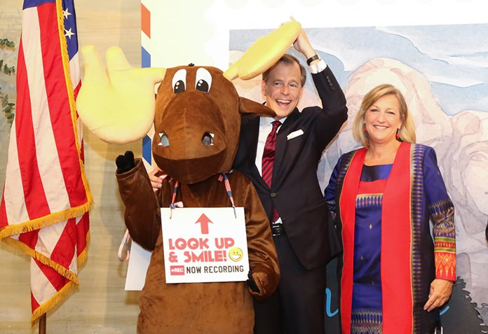 H.E. Glyn T. Davies and wife Jacqueline pose with a national park mascot.