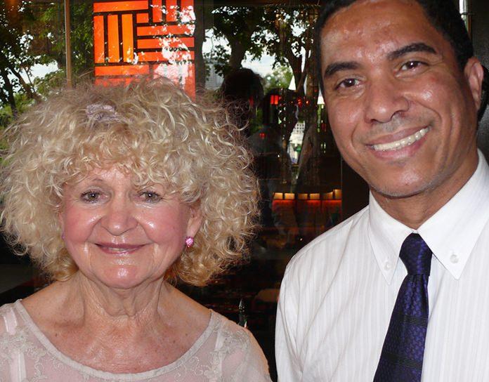 Reni Hildenbrand (left) with Assistant Ambassador Deon Seals.