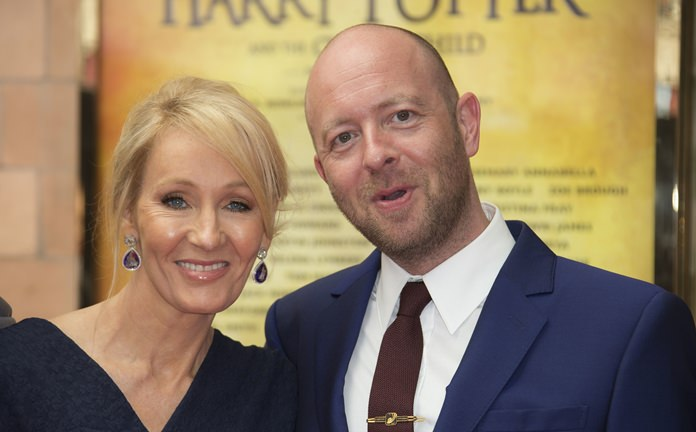 Writer J.K. Rowling (left) and Director John Tiffany pose for photographers upon arrival at the gala performance of Harry Potter and the Cursed Child, at the Palace Theatre in central London, Saturday, July 30. (Photo by Joel Ryan/Invision/AP)