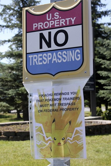 """In this Tuesday, July 12, 2016, file photo, a sign at the National Weather Service in Anchorage, Alaska, informs """"Pokemon Go"""" players that it's illegal to trespass on federal property. The staff started noticing an uptick of people in the parking lot after the location was included as a gym in the popular game. (AP Photo/Mark Thiessen, File)"""