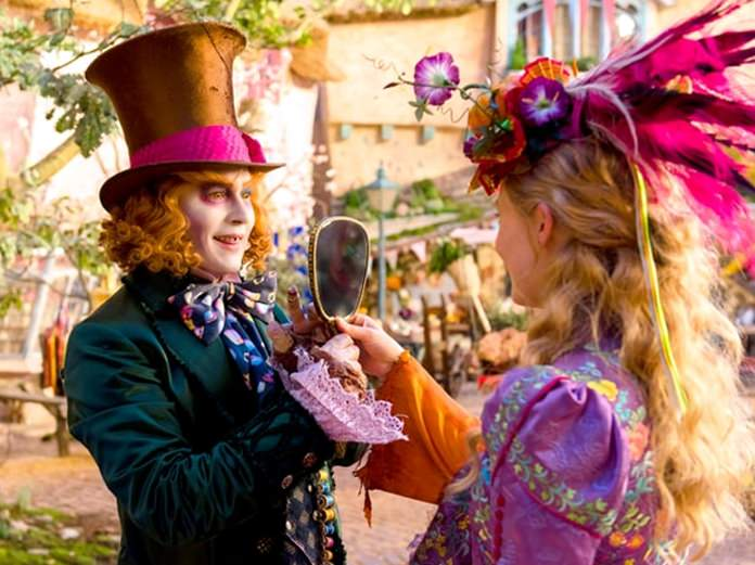 "Johnny Depp as the Mad Hatter (left) and Mia Wasikowska as Alice are shown in a scene from ""Alice Through the Looking Glass"". (Photo/Walt Disney Pictures)"