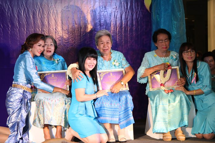 "Some of the more than five dozen women Pattaya City Council honored as the area's ""best moms"" for Mother's Day are brought to the stage with their daughters."