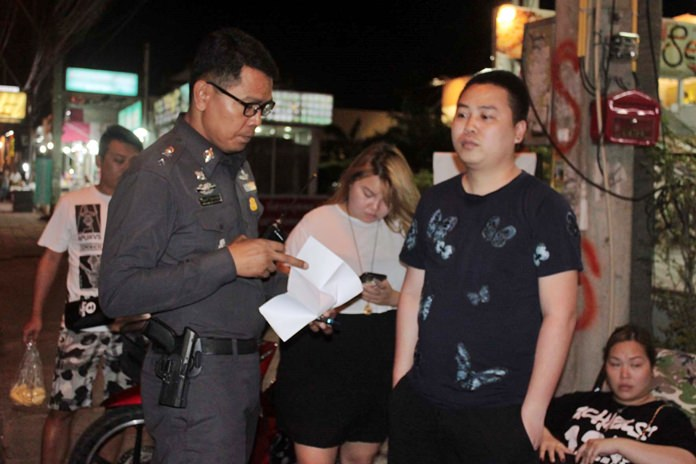Chen Wi Xian reports to police how a teen on a motorcycle snatched his expensive gold chain.