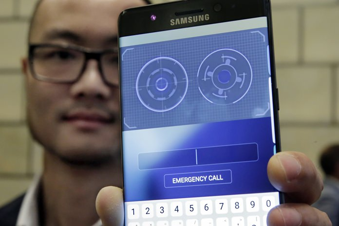 In this July 28, 2016, photo, Jonathan Wong of Samsung's Knox Product Marketing, shows the iris scanner feature of the Galaxy Note 7, in New York. (AP Photo/Richard Drew)