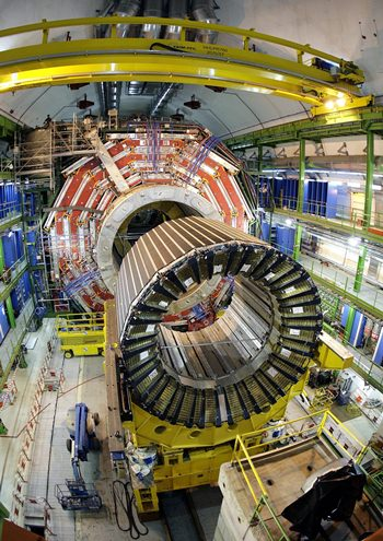 """Disappointed physicists from the Large Hadron Collider report that what initially could have been an intriguing new particle turned out just to a statistical burp. Last December, researchers at the European Center for Nuclear Research saw two readings of what could have been a new particle that would not have fit with the existing main physics theory. The same center in 2012 discovered the Higgs boson or """"God particle."""" (AP Photo/Keystone, Martial Trezzini, File)"""