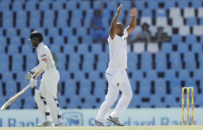 South Africa's bowler Vernon Philander, right, reacts after dismissing New Zealand's batsman Doug Bracewell for 5 runs on the fourth day of their second cricket test match at Centurion Park in Pretoria, South Africa, Tuesday, Aug. 30. (AP Photo/Themba Hadebe)