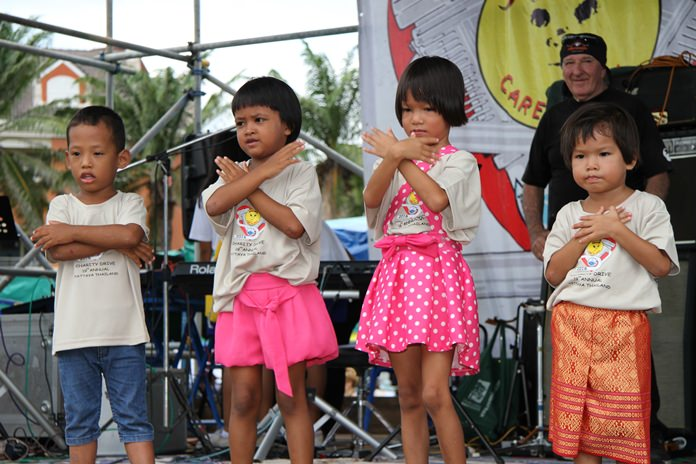Little ones bring smiles to everyone's faces during their adorable performance.