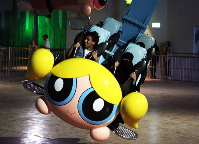 People shout as they experience the Powerpuff Girls - Mojo Jojo's Robot Rampage ride at the IMG Worlds of Adventure amusement park in Dubai, United Arab Emirates, Wednesday, Aug. 31. (AP Photo/Jon Gambrell)