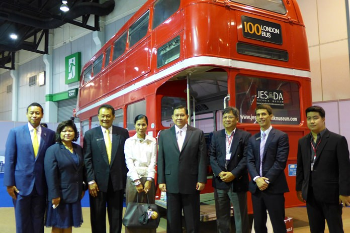 Deputy Prime Minister General Tanasak Patimapragorn (4th right) and Minister of Tourism & Sports Kobkarn Wattanavrangkul with delegation next to a genuine classic London Routemaster bus on display at Thai-UK 2016.