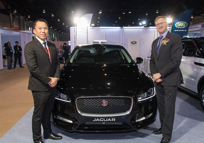 Jaguar/Land Rover took pride of place at the entrance of Thai-UK 2016. Managing Director Charnchai Mahantakun (left) introduces the latest models to H.E. British Ambassador Brian Davidson.