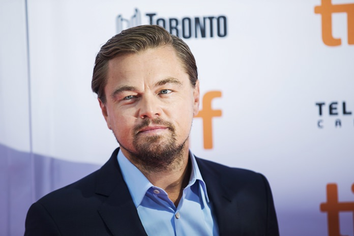 "Actor Leonardo DiCaprio arrives on the red carpet to promote the film ""Before The Flood"" during the Toronto International Film Festival on Friday, Sept. 9. (Michelle Siu/The Canadian Press via AP)"