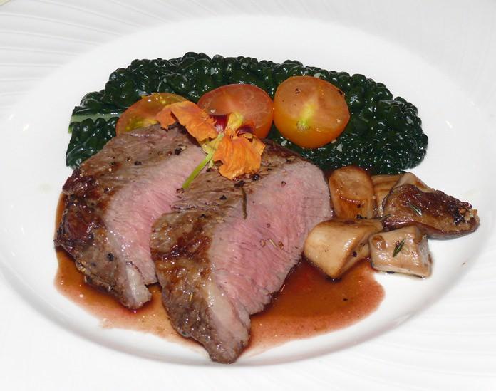 Very tender oven-roasted Galician rib eye steak on a Barolo reduction.
