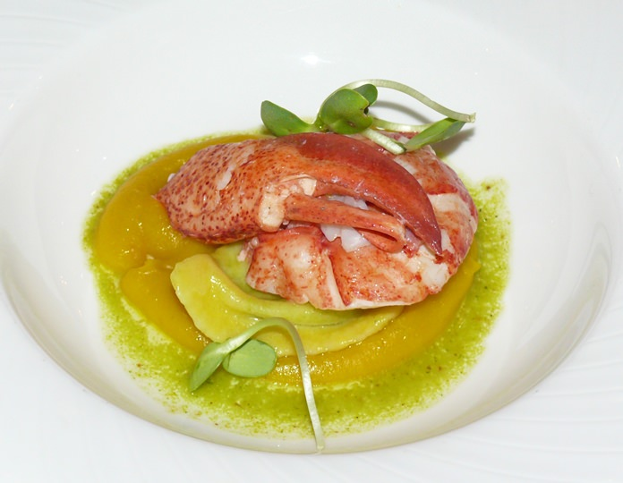 Butter-poached Maine lobster tail on a crushed sweet pea Agnolotti butternut squash and pistachio vinaigrette.