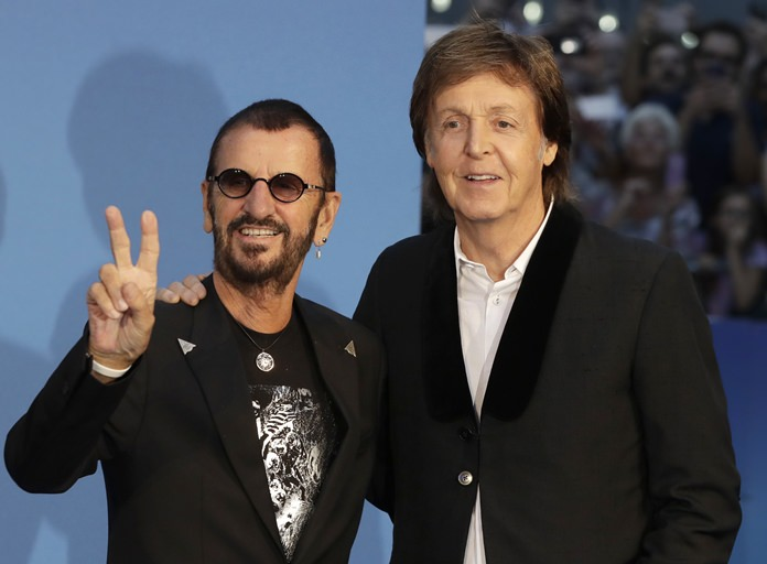 Musicians Paul McCartney (right) and Ringo Starr pose for photographers upon arrival at the World premiere of the Beatles movie, Ron Howard's 'Eight days a week-the touring years' in London, Thursday, Sept. 15. (AP Photo/Kirsty Wigglesworth)