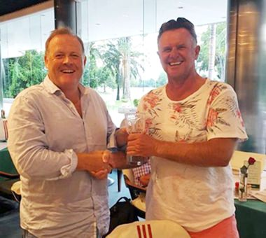 Colin Greig (right) receives his trophy after winning the Hu Hin golf tour.