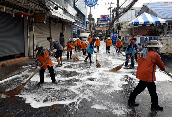 City workers give Walking Street a good scrubbing.
