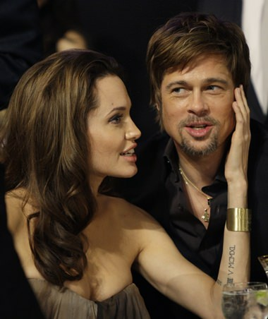 Angelina Jolie and Brad Pitt are shown together in this Jan. 27, 2008 file photo. (AP Photo/Kevork Djansezian)