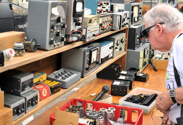 Joel Goldberg, of Newton, Mass., browses MIT's Radio Society flea market. (AP Photo/Collin Binkley)