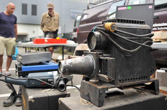 A photo slide Magic Lantern projector, circa 1930, is displayed at MIT's Radio Society flea market on the campus of the Massachusetts Institute of Technology in Cambridge, Mass. (AP Photo/Collin Binkley)