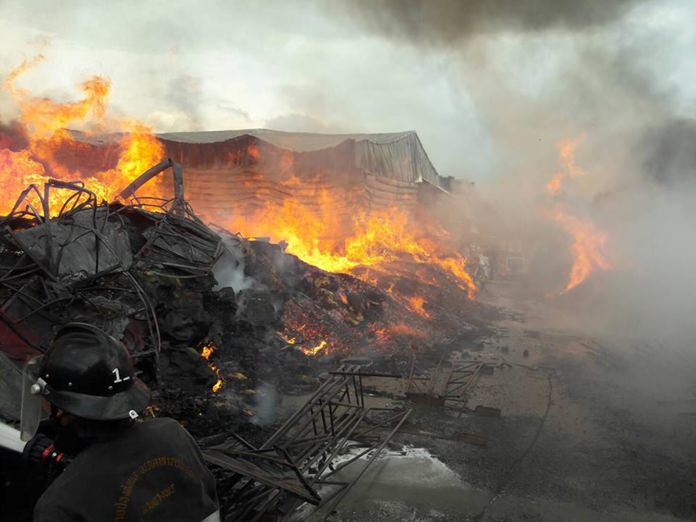 Fire destroyed a scrap warehouse near the Amata City industrial estate in Sriracha, but injured no one.