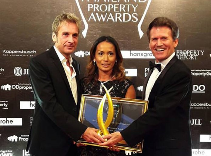 Winston Gale (left) and Sukanya Gale (centre) receive the 'Best Luxury Condominium 2016' award for the Riviera Wongamat Beach from Clayton Wade (right), Managing Director of Premier Homes Real Estate, during the Thailand Property Awards ceremony in Bangkok, Sept. 22.
