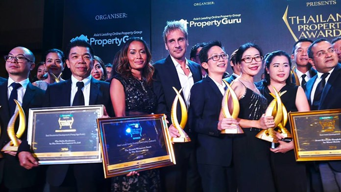 Sukanya and Winston Gale (centre) celebrate with other category winners on stage at the conclusion of the 2016 Thailand Property Awards.