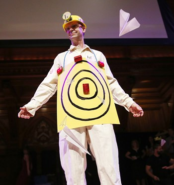 Human Aeorodrome Eric Workman acts as a target for paper airplanes during the Ig Nobel award ceremonies at Harvard University in Cambridge, Mass., Sept. 22. (AP Photo/Michael Dwyer)