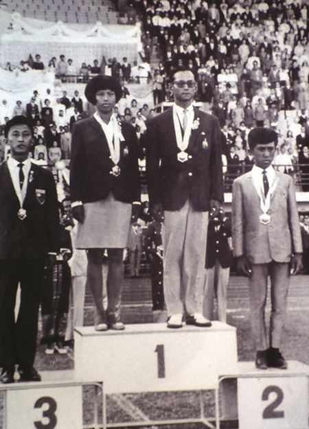 HM the King and HRH Princess Ubolratana on the winners' podium: SEAP Games, December 1967.