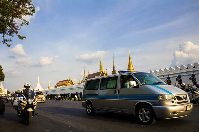 A van carrying the body of HM King Bhumibol Adulyadej leaves Siriraj Hospital for Grand Palace in a procession led by his son and heir apparent Crown Prince Vajiralongkorn in Bangkok Friday, Oct. 14, 2016. (AP Photo/Wason Wanichakorn)