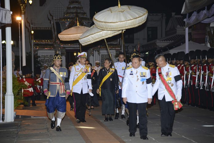 Crown Prince Vajiralongkorn, left, and Princess Sirindhorn, right, arrive at Grand Palace before presiding over a Buddhist funeral rite at a hall inside the Grand Palace Friday, Oct. 14, 2016. (Bureau of the Royal Household via AP)