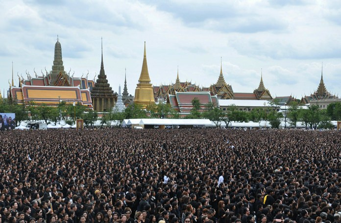 More than 300,000 mourners sing a special version of Thailand's Royal Anthem in honour of HM King Bhumibol Adulyadej, Saturday, Oct. 22, 2016. (AP Photo/Sompong Sonnak)