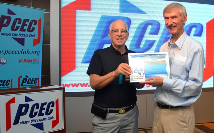 MC Richard Silverberg presents the PCEC's Certificate of Appreciation to member Ian Frame for his presentation of photographs showing that Pattaya's streets and beaches can reveal some truly amazing sights.