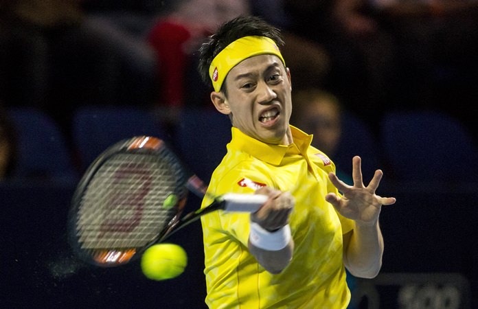 Japan's Kei Nishikori returns a ball to Argentina's Juan Martin Del Potro, during their quarterfinal tennis match at the Swiss Indoors tennis tournament in Basel, Switzerland, on Friday, Oct.28. (Alexandra Wey/Keystone via AP)